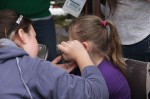 Face painting is a popular attraction at the street fair.