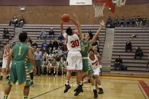 Hawks struggle on both sides of the court, fall 26-49 to Roosevelt