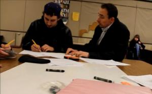 Math teacher Spencer Stiglets (right) helps a student after school about a math problem.