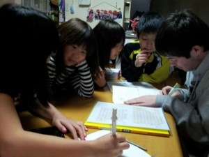 Cuplin gets some help from young new friends while working on his Japanese characters.
