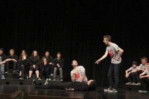 Bryan Wilson and Myles Stillwaugh, along with a member of the Inglemoor team, deliver a hilarious performance during one of the theater sports events.