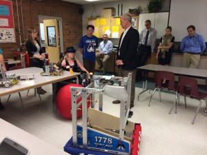 MTHS FIRST Robotics members show off their robots to Larsen.